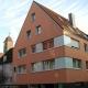 Wohn- und Geschäftshaus - Wärmedämmverbundsystem statt Faserzementplatten
